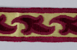 Design of a detached leaf between straight borders. In red velvet on a yellow ground.