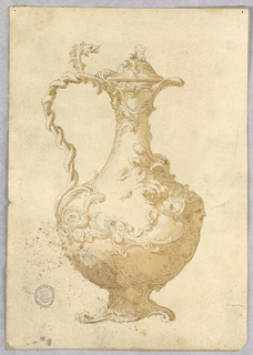 A ewer, spout facing right. A dragon twisting around the handle. A and S curved applied throughout body and on lid. Flowers and mask on body at right.