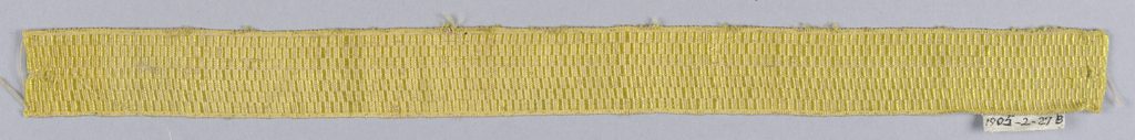 Trimming woven in a yellow checkerboard design.