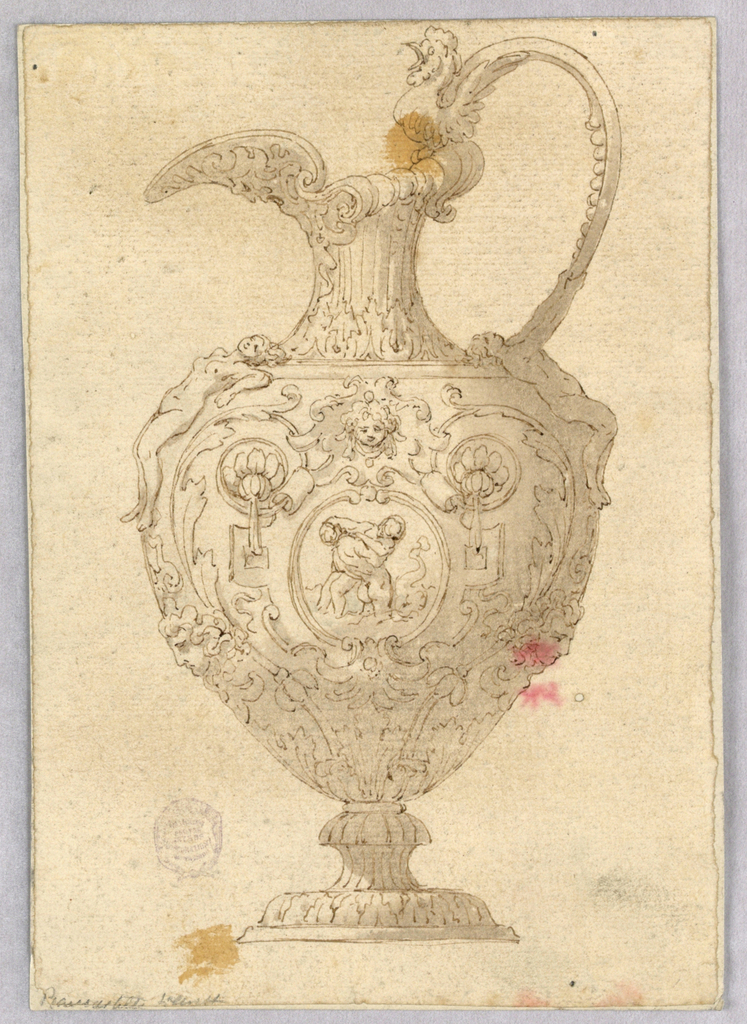 An ewer with a cock on its handle and a mask antefix. The body richly decorated with strapwork and ignudi.  At center, a medallion with figures.