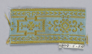 Greek key design in blue and yellow