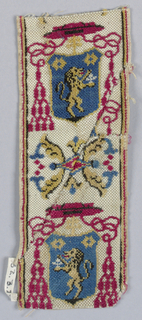 Trimming for livery with a design of ecclesiastic's hat over shield showing lion rampant alternating with ornament of conventionalized flowers. In red, blue and yellow on white ground.