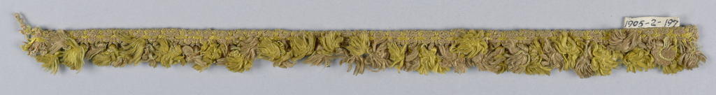 Yellow and pink fringe with a heading and striped skirt threads in short loops holding tufts.