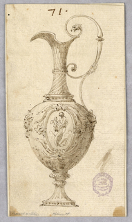 An ewer with the spout facing left. Scrolling handle terminating in a bird's head. Body decorated with two masks and relief floral work framing a center medallion.