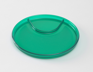 Transparent green plastic plate with beverage well and lip
