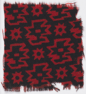 Geometric design in black on red.