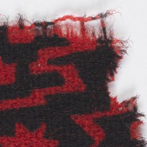 Geometric design in black on red.