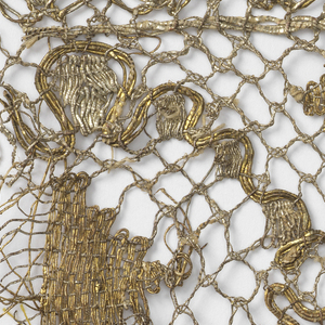 Fragment has a design of crossing lines with solidly worked lozenges and two scalloped edges in gold and silver color thread.