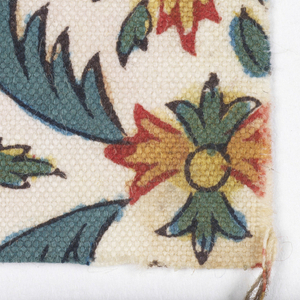 Flowers and leaves in two reds, yellow, blue and black on white.