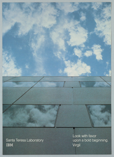 Photograph of a view of a building and the sky from below. Text in white, lower left: Santa Teresa Laboratory / IBM [logo]; lower right: Look with favor / upon a bold beginning. / Virgil.