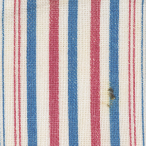 Yellow and brown shapes on whaite alternate with red and blue stripes.