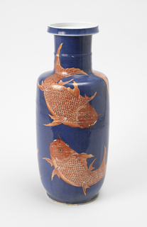 Cylindrical vase with narrow neck, wide circular mouth, and slightly tappered base; overall decoration showing several large red carp swimming on a blue ground.