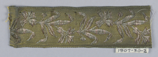 Galloon fragment with design of flowers and leaves in vine arrangement in tinted metal threads on gilt ground; furnishing trim