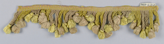 Pink and yellow fringe with a heading and looped skirt threads graduated to form scallops; each group of threads supporting a tassel of the other color.