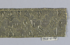 Design of leaves placed alternately up and down in yellow and white with silver thread.