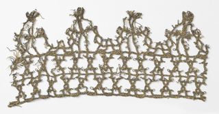 Fragment of metallic lace with triangular tabs made from loose interlacings.