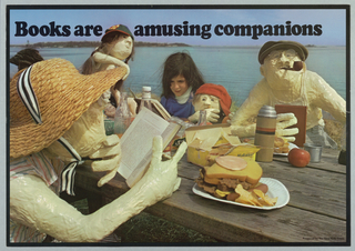 """Photograph of a group of figures: one girl and a """"family"""" of plaster figures all reading at a picnic table with lunch. Above in black: Books are amusing companions."""