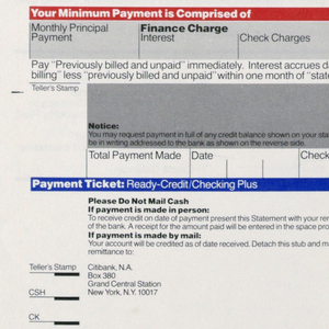 Citibank ready credit checking statement and payment form, printed once on single page. Citibank logo in blue at top right with blue line above. Below grey box with black text subdivided into five different registers for different information. Top and bottom registers have orange heading bar, middle three have black. At bottom removable payment ticket with black text with Citibank logo in blue at top right with blue line above.