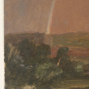 A view of open countryside consisting of low rolling hills and low vegetation, over which a rainbow arches.