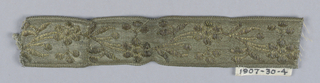 Galloon with design of curving stem with flowers, leaves and fruit; furnishing trim