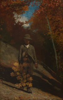 Vertical view of a boy in foreground standing on hillside and holding in his right hand a branch of yellow maple leaves.  In background, are deep shadows and trees with autumn foliage.