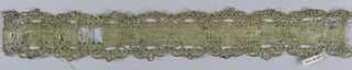 Design of a scalloped border in white with silver thread.