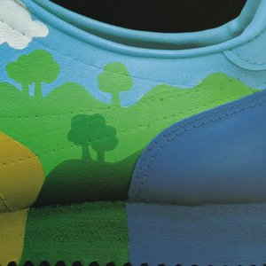 "Profile of a sport shoe decorated with a cartoonish landscape. In white upper left: If the shoe fits, / run it. Blocks of white text describing an event that will take place. Upper right Fartlek logo (Fartlek is a type of solo running; in Swedish = ""speed play"")."