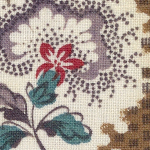 Flowers, stripes and squares in lavendar, black, red and green on white.