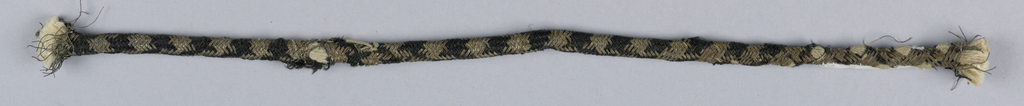 Strands of silk and metal thread woven in an ornamental pattern around a cotton core. a] black silk and silver thread - b and  d] silver thread - c and e] gilt thread - strands of silk and metal thread wrapped around a small core are twisted together to form a larger cord.