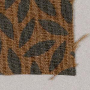 Black ovals on brown background.