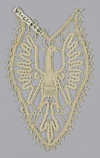 Ornament for corners in design of bird with wings spread.
