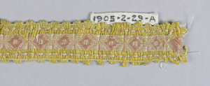 Design of white lozenges set in a red square with yellow borders and a scalloped picot edge.
