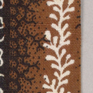 Leaf chains, vermicular lines and dots in black and white on stripes of blue and brown.