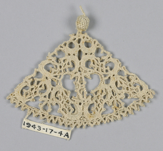 Cone shaped ornaments finished with small button at the bottom or top.