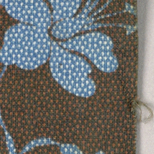 Dotted blue flowers and stems on a brown background.