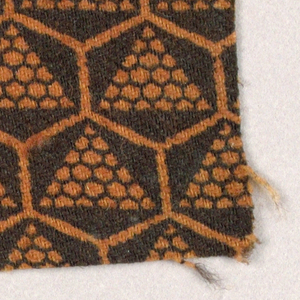 Triangles of net-like shapes in hexagons in black on rust.