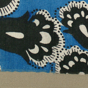 Silhouetted floral forms in black and white; (a) blue ground, (b) green ground.