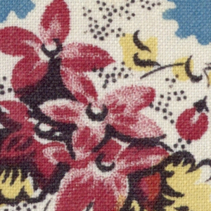 Floral spray: red, yellow and black on white in blue square with geometric shapes in lavendar at bottom and small flowers and vermicular shapes at right.