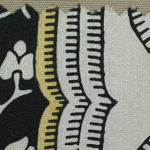 Pattern incomplete. Ogives formed of three layers of dashed black lines, innermost with a pale yellow fill; black center with ivory flowering branch; ivory ground. Direction of ogives alternates from vertical to horizontal orientation.