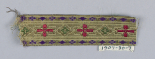 Trimming (galloon) with design of a cross in red silk, alternating with lozenge in green silk, between borders with small lozenge and flower in purple silk; on ground of metallic gold thread; furnishing trim