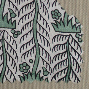 Stylized pine tree form in green and black on an ivory ground.