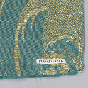 Eight samples of wide ribbon each with a solid colored satin ground shot with metallic thread and a design of serpentine pointed, serrated, and ornamental leaves in gold or silver.