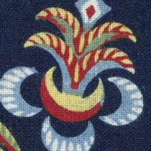 Part of flower and floral spray in red, yellowm medium blue, and white.
