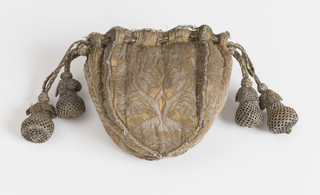 Small purse with four identical shield-shapes sides and a draw-cord top, lined with blue silk damask. On each side is a symmetrical design of a flowering plant with birds perched in the branches. The panels are joined with narrow gold braid; the top is bound with the same. Beads at the ends of the draw-cord are covered with silver and gold net.