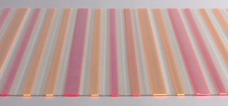 Woven white vinyl mesh with orange and pink flourescent acrylic bars in two widths inserted in the pockets formed by the double-weave structure.