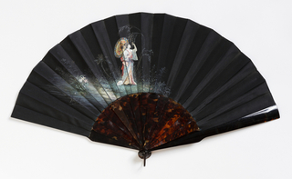 Painted double taffeta leaf, black on one side and light green on the other. Obverse: scene of a lady in Japanese dress with a parasol against a landscape. Fine and delicate workmanship.  Sticks: imitation tortoise shell.