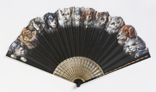Pleated fan with a leaf of painted black silk crêpe. Sticks are carved à jour and painted wood.