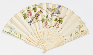 Pleated fan with a painted parchment leaf showing a goldfinch with berries of either Bryony, a climbing vine whose berries are poisonous, or Guelder Rose (Vibernum Opulus), both of which grow wild in Europe. Drilled and pierced bone sticks. Mother-of pearl washer and metal bail at the rivet.