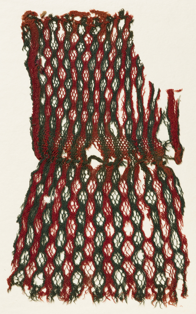 Fragment of headcovering or bag striped alternately red and green, with pattern of decorative holes.