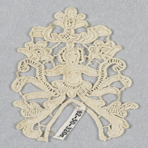 Corner ornament with floral forms with the figure of a siren in the center. Modes: cordonnet, brides.